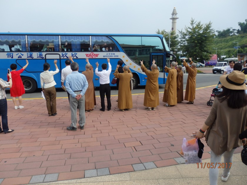 Buddhists Students wave good-bye to tourists