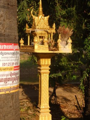 These little prayer temples are commonly seen in people's front yards and businesses.
