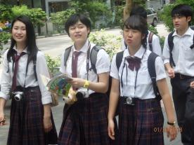 School uniforms are seen everywhere.